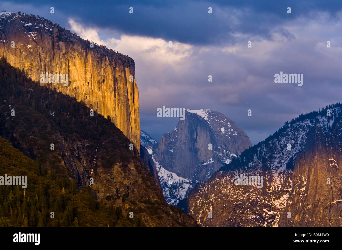 sunset light on el capitan and storm clouds over half dome and stock
