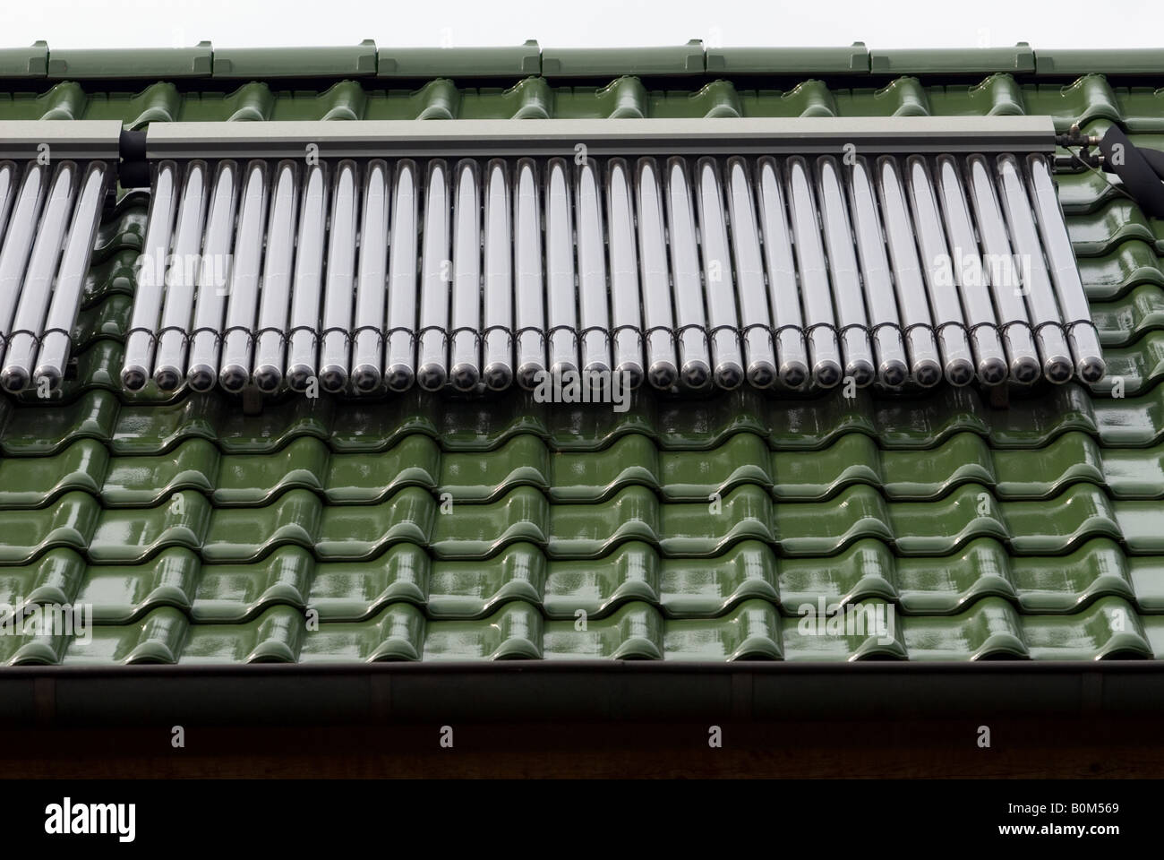 Solar Evacuated Tubes on the roof of a house in Horst near Werne, North Rhine Westphalia, Germany. - Stock Image