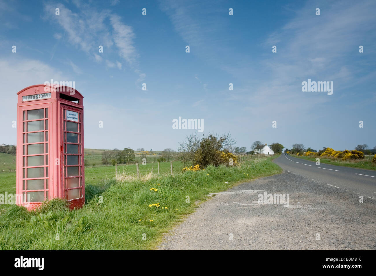 Soon to be an icon of the past as the BT announces the removal of 14 000 red phone boxes from across the country. - Stock Image