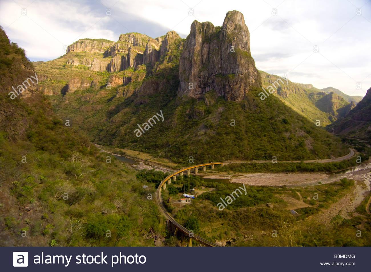 View from the Chihuahua al Pacifico Railroad Chepe train down onto the Santa Barbara Bridge near Temoris the Copper - Stock Image