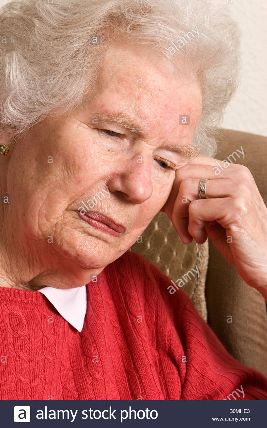 Unhappy old woman. - Stock Image