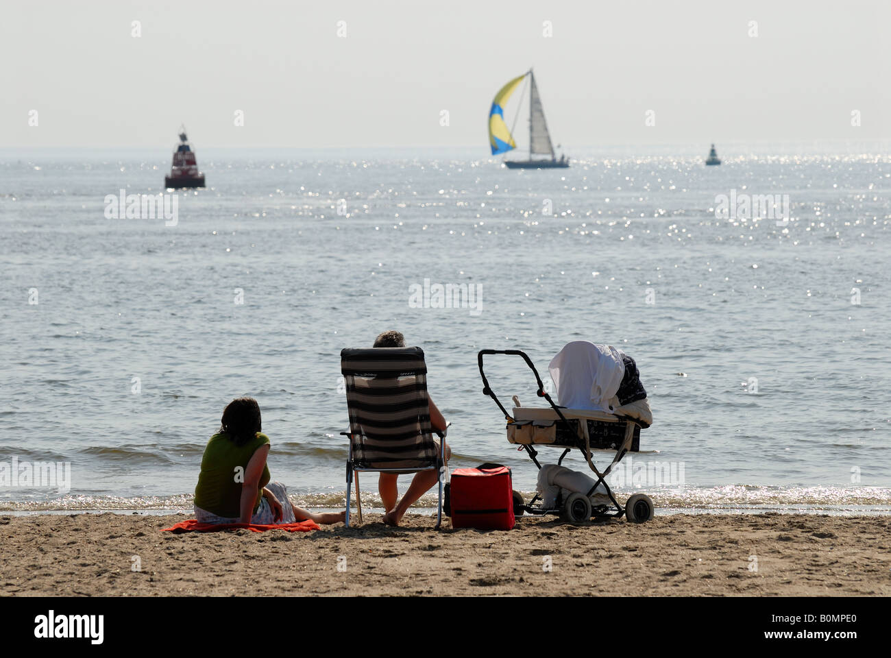 Family on the beach in Netherlands - Stock Image