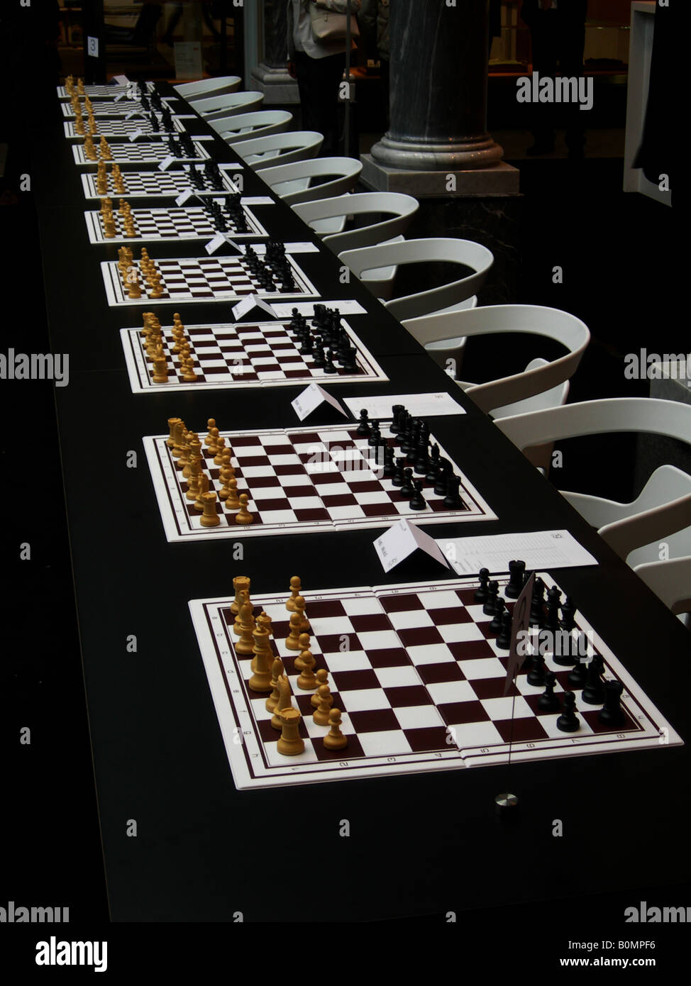 many chess boards for simultaneous games - Stock Image