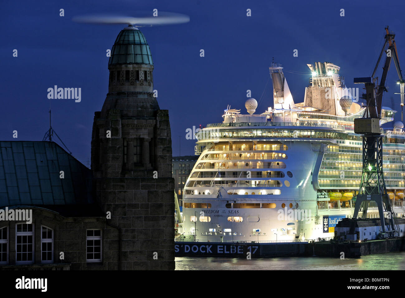 The cruise ship ' Freedom of the Seas' in dock of Blohm + Voss with historic landing bridges Landungsbruecken, - Stock Image