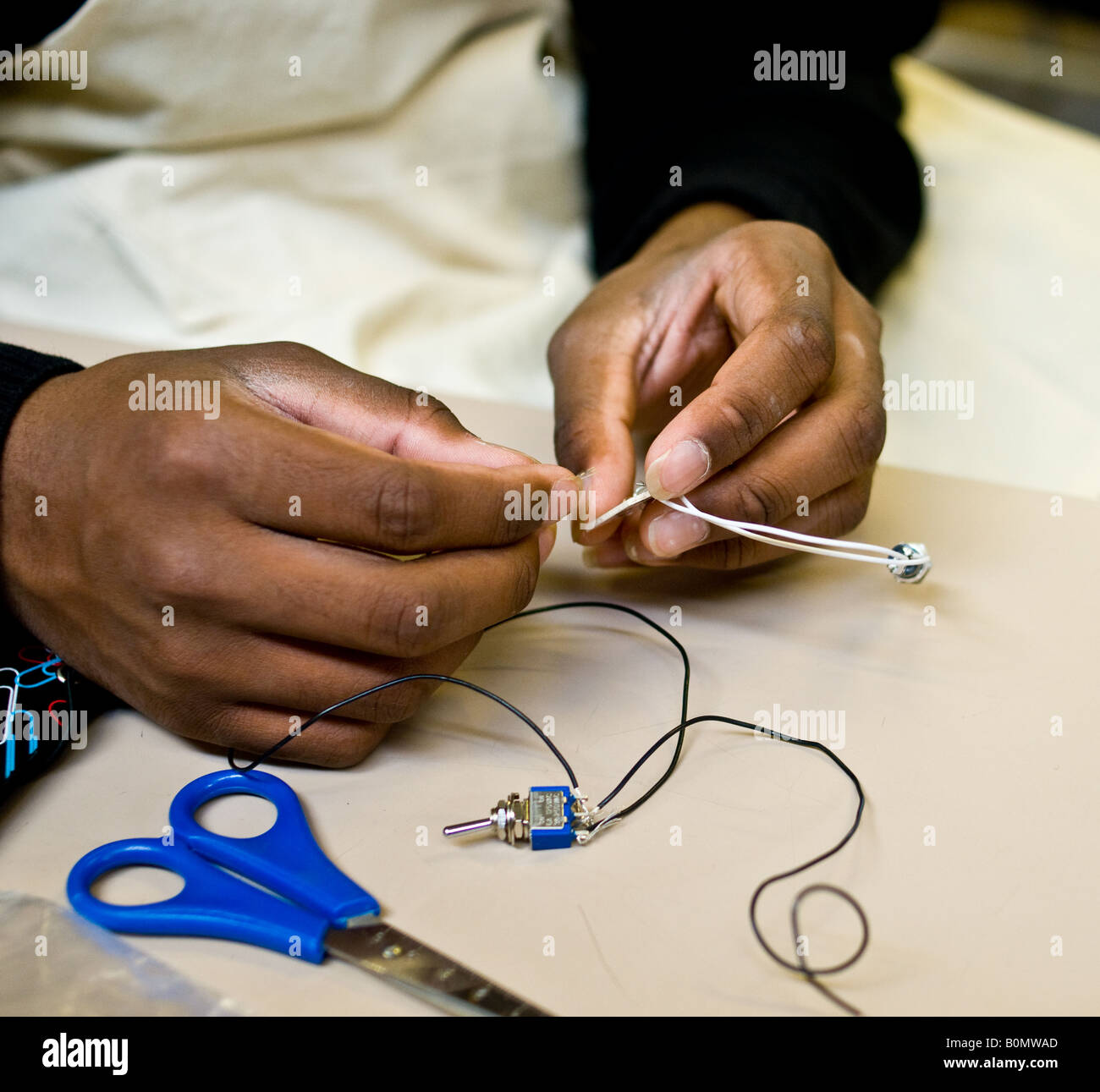 Education - A student working in a school practical electronics lesson. - Stock Image