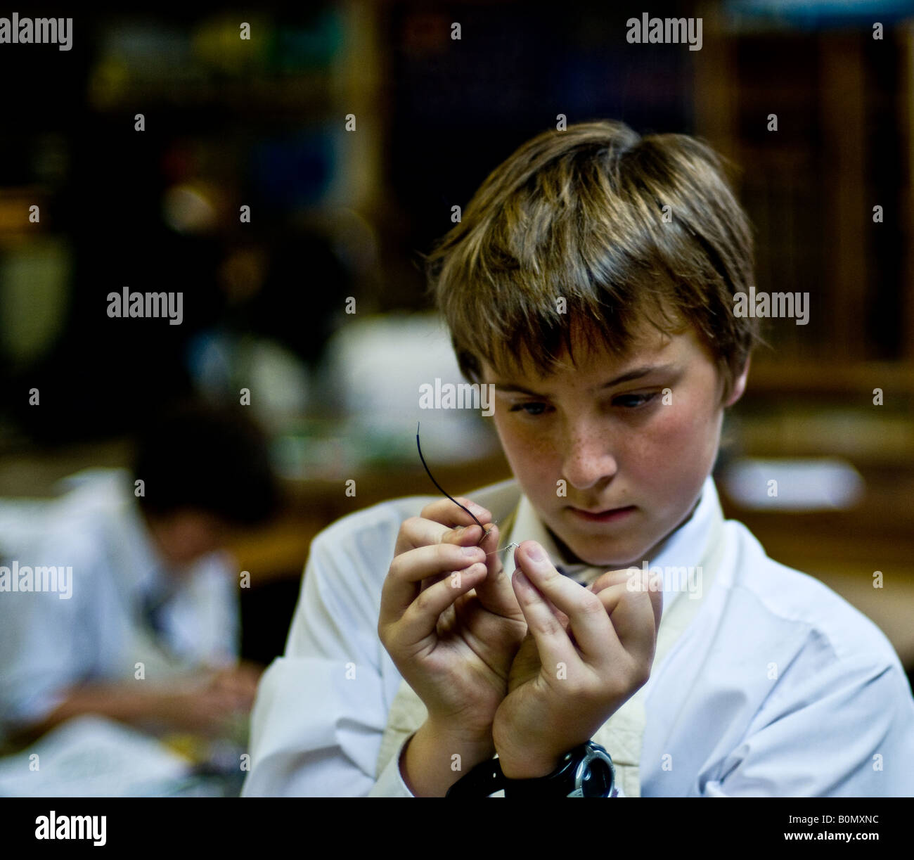 Education - A student working in an electronics class. - Stock Image