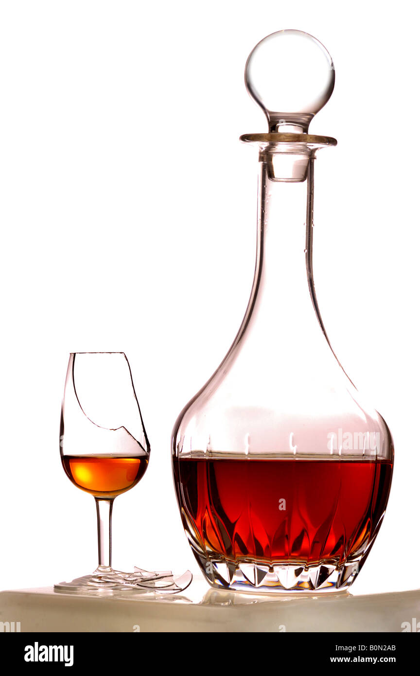Sherry decanter and broken glass - Stock Image
