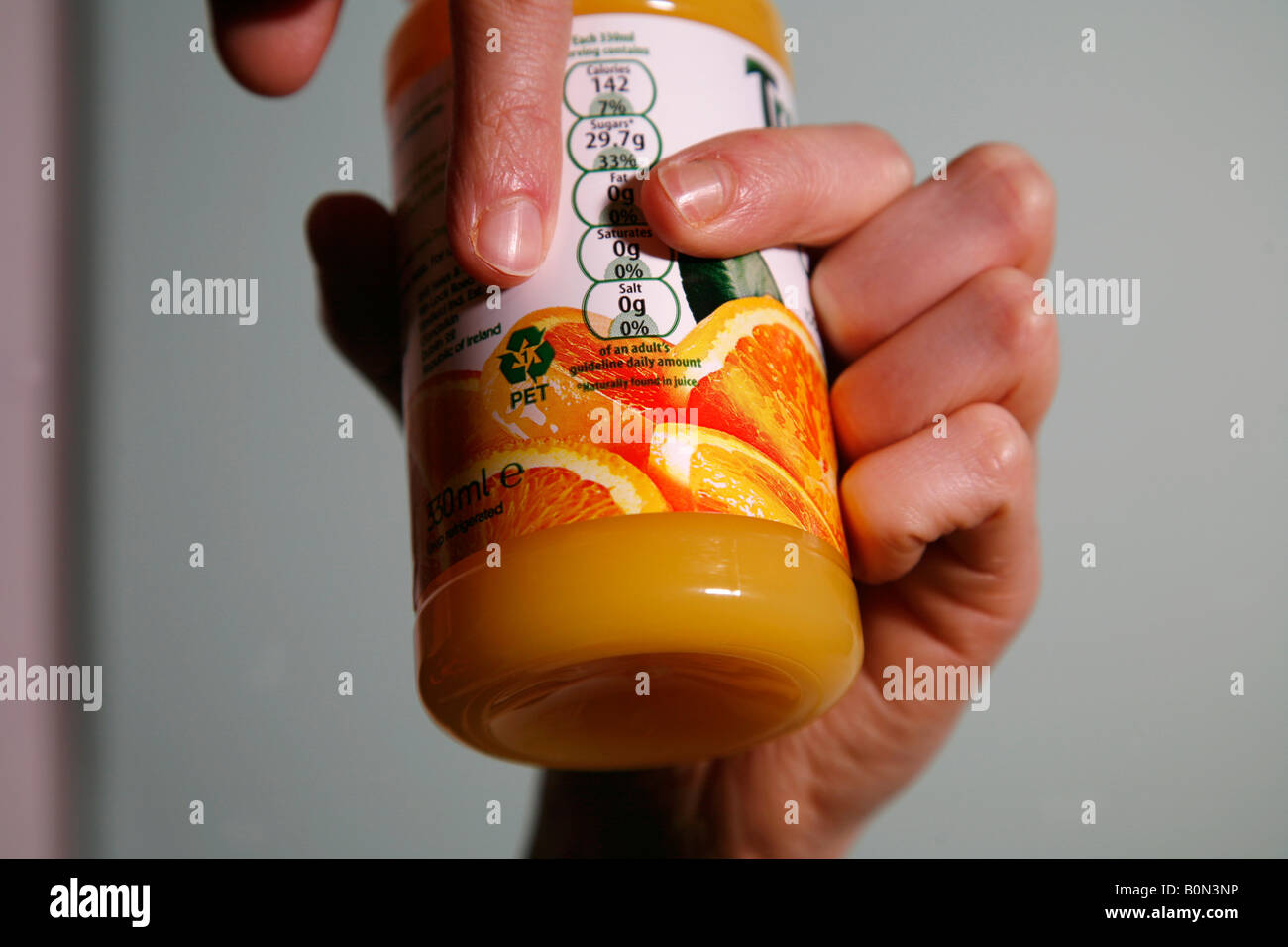 Recycling plastic orange juice bottle, container - Stock Image