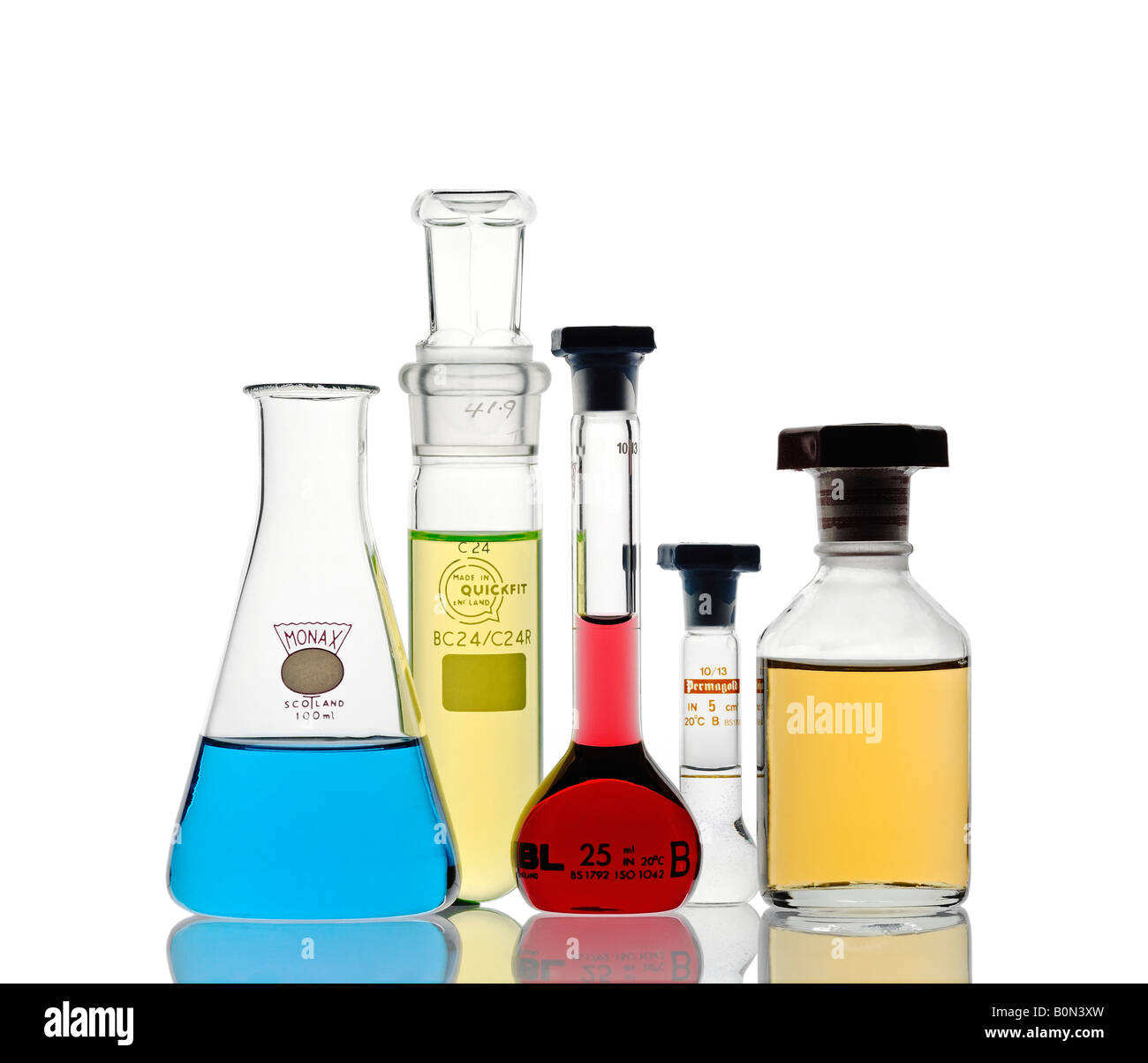 Laboratory Glassware Filled with Chemicals - Stock Image