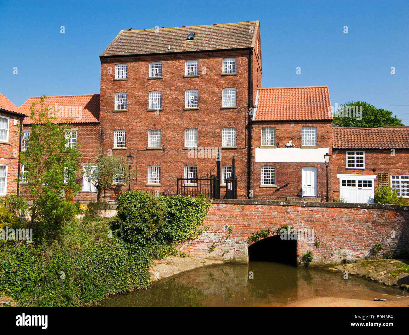 Victorian Church Mill on river Rase converted for housing and new development at Market Rasen, Lincolnshire, UK - Stock Image