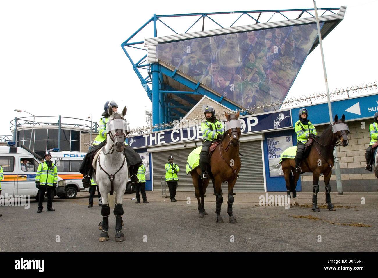 Riot police outside the Millwall football stadium The New Den before the Millwall vs Leeds playoff match. - Stock Image