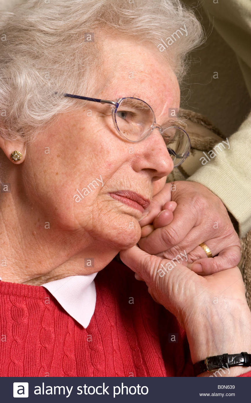 elderly woman with dementia and Alzheimers with carer, UK. - Stock Image