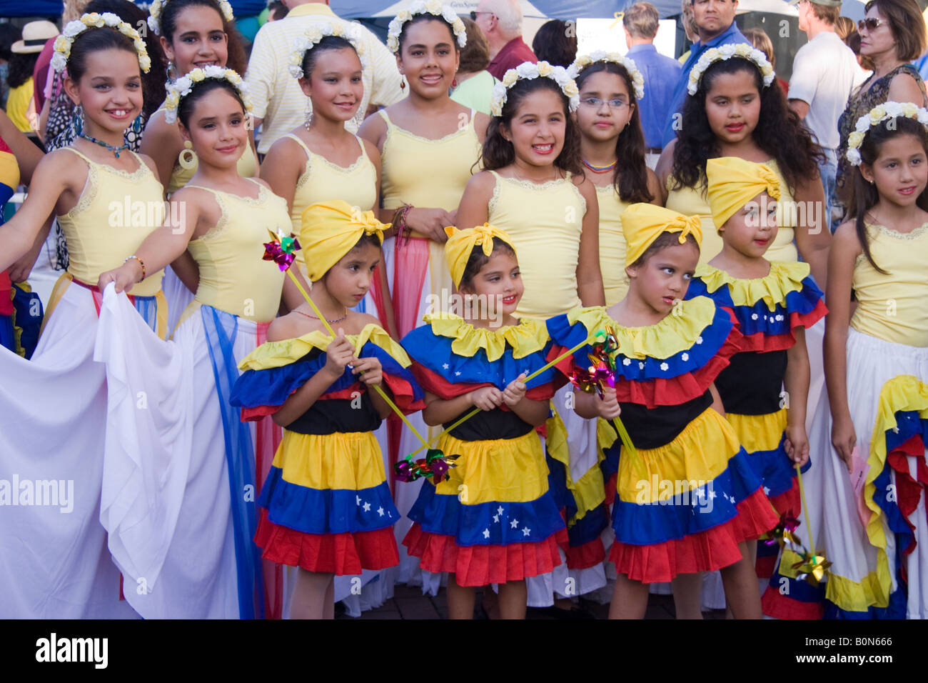 Young girls in costume pose for photograph  before giving a dance exhibit during a Latin Festival in Florida - Stock Image