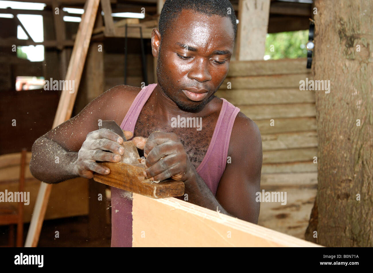 Carpenter at work in a cabinetmaking, Accra, Ghana - Stock Image