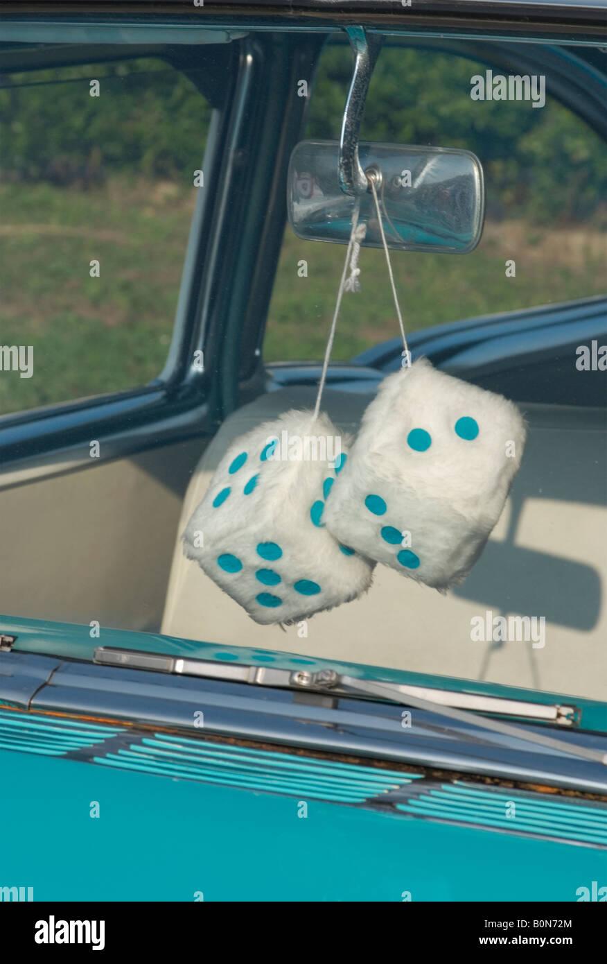 Fuzzy Dice Hanging From Rear View Mirror - Stock Image