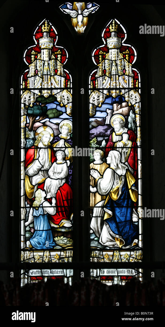 Hoverton Church Norfolk Stained Glass Window Depicting the Bible Story Suffer the Little Children to Come Unto Me - Stock Image