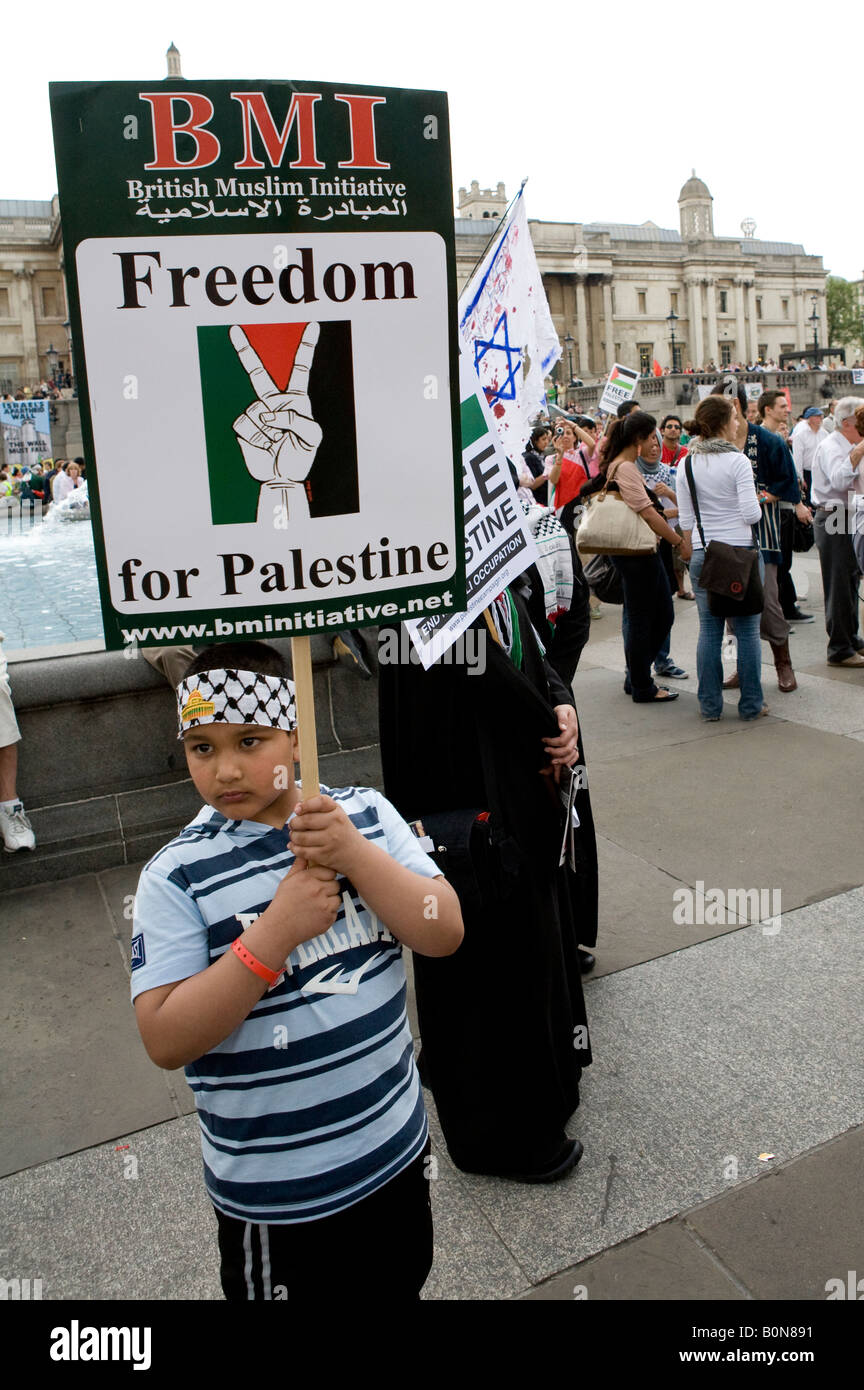Young Boy Holding Banner At The Freedom For Palestine Raleigh Trafalgar Square London UK Europe - Stock Image