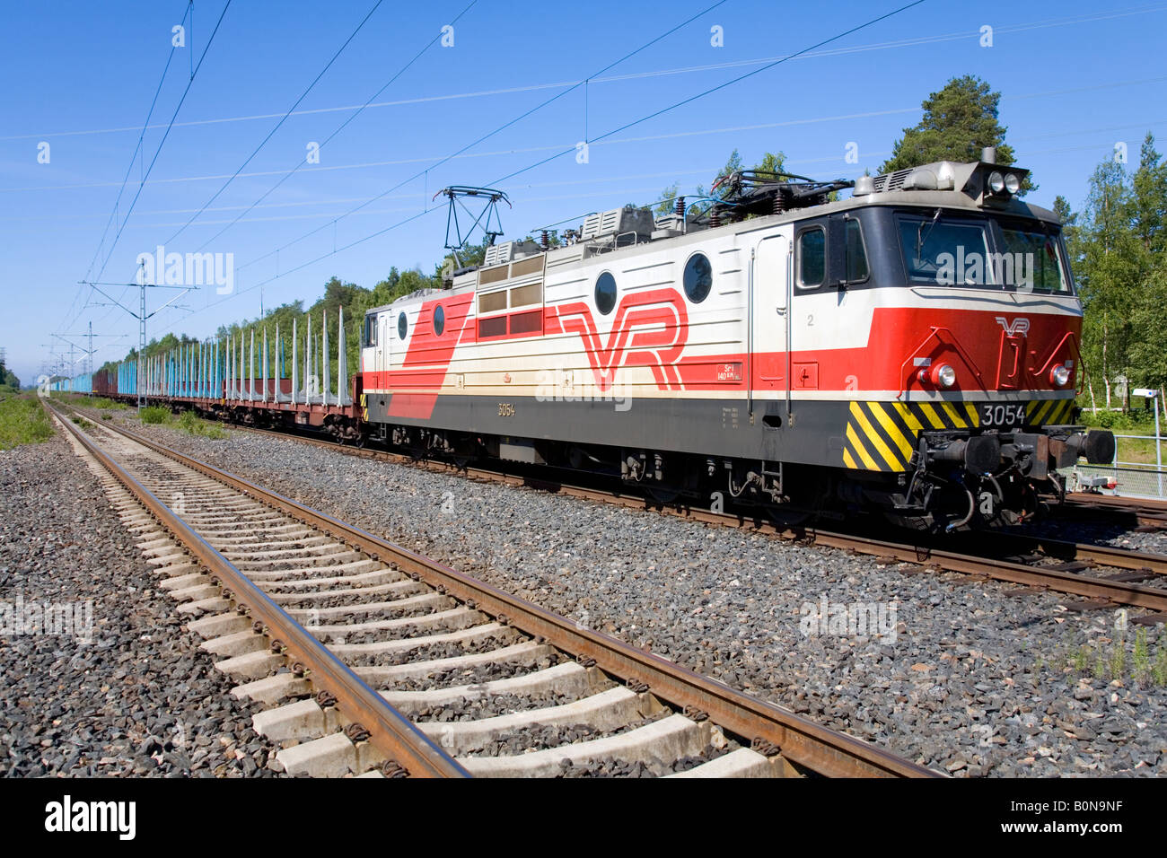 Finnish cargo train locomotive owned by VR and concrete sleepers on rails , Finland - Stock Image