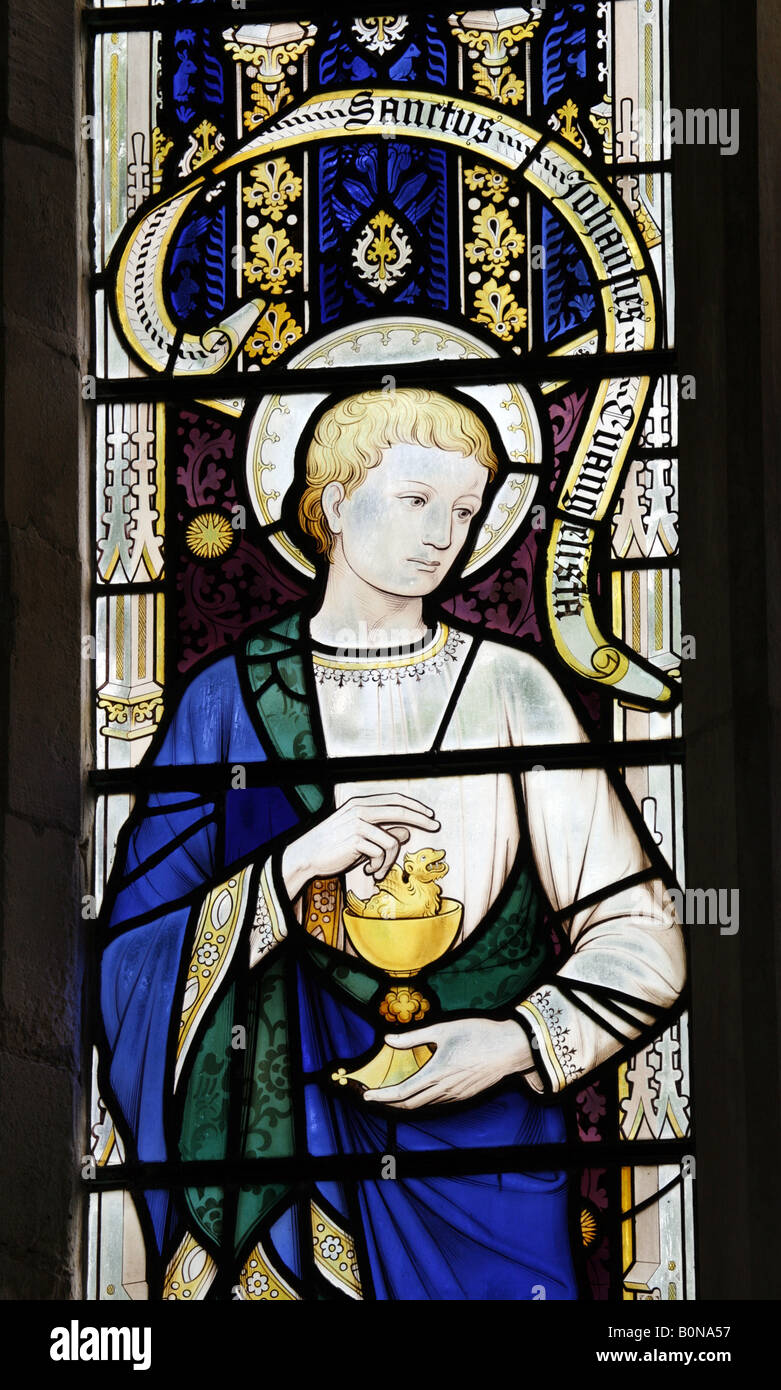 Stained Glass Window Depicting Saint John the Evangelist with poisoned chalice and serpent emerging; Hoverton Church - Stock Image