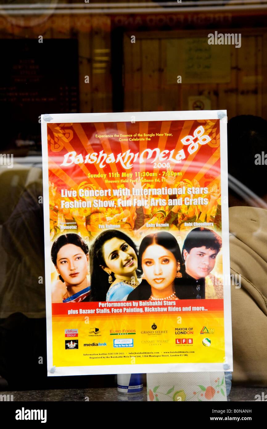 Concert poster in store window Brick Lane London UK - Stock Image