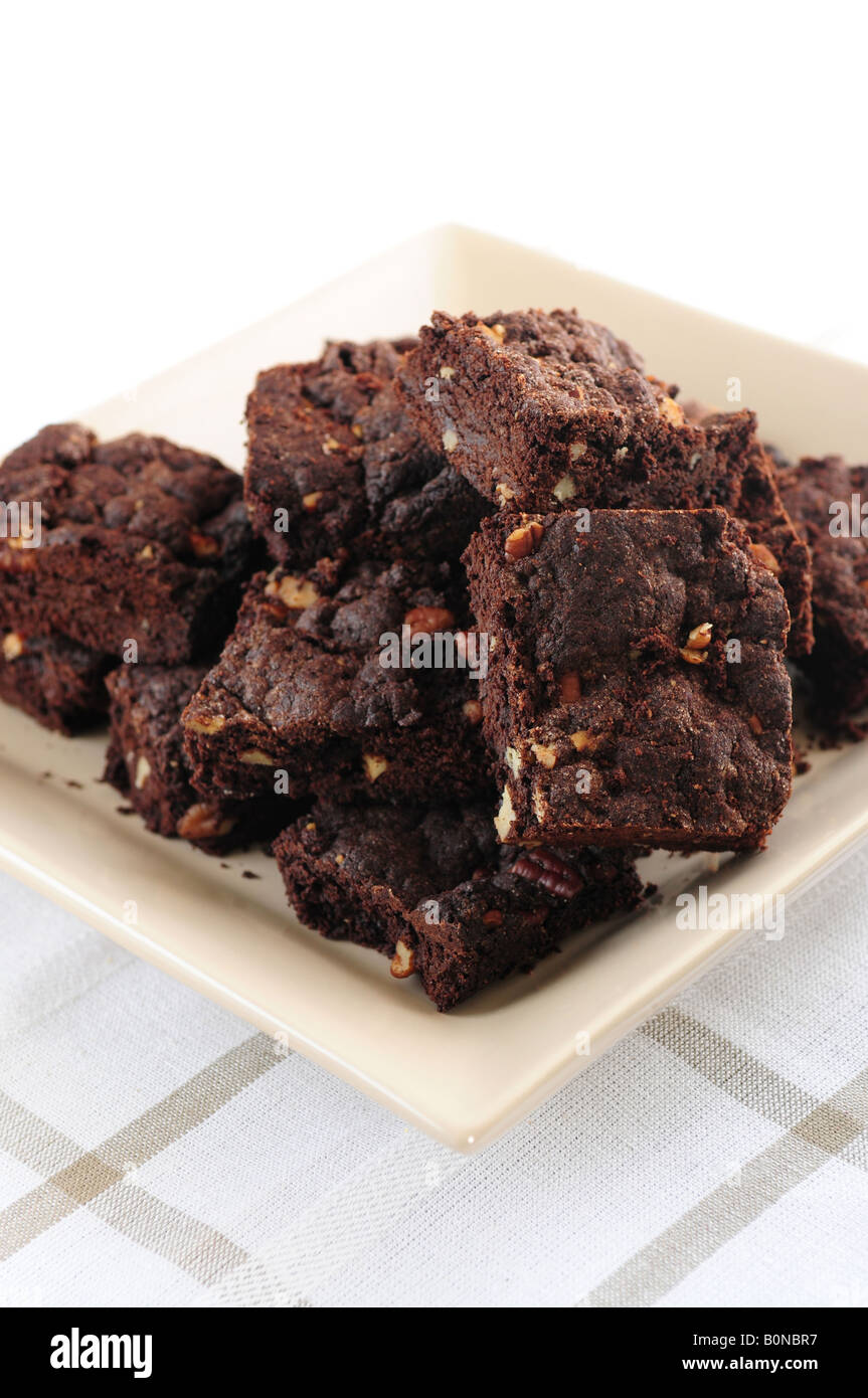 Homemade chocolate brownies served on a plate - Stock Image