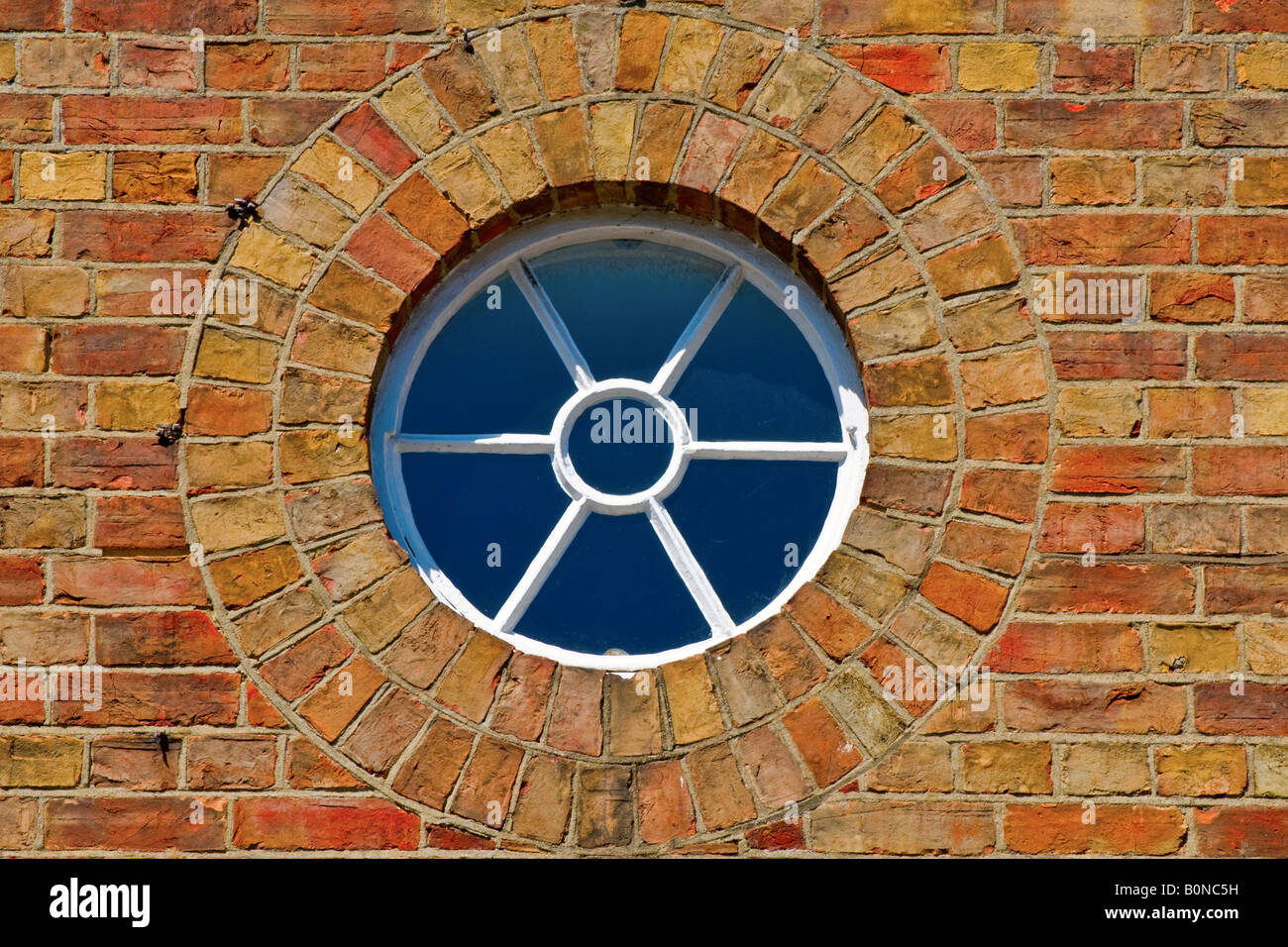 A round wooden window - Stock Image