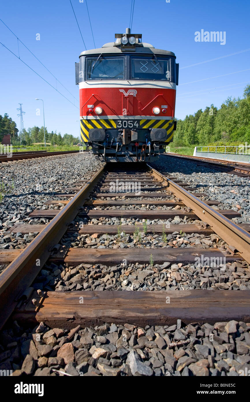 Electric locomotive and wooden sleepers on rails , Finland - Stock Image