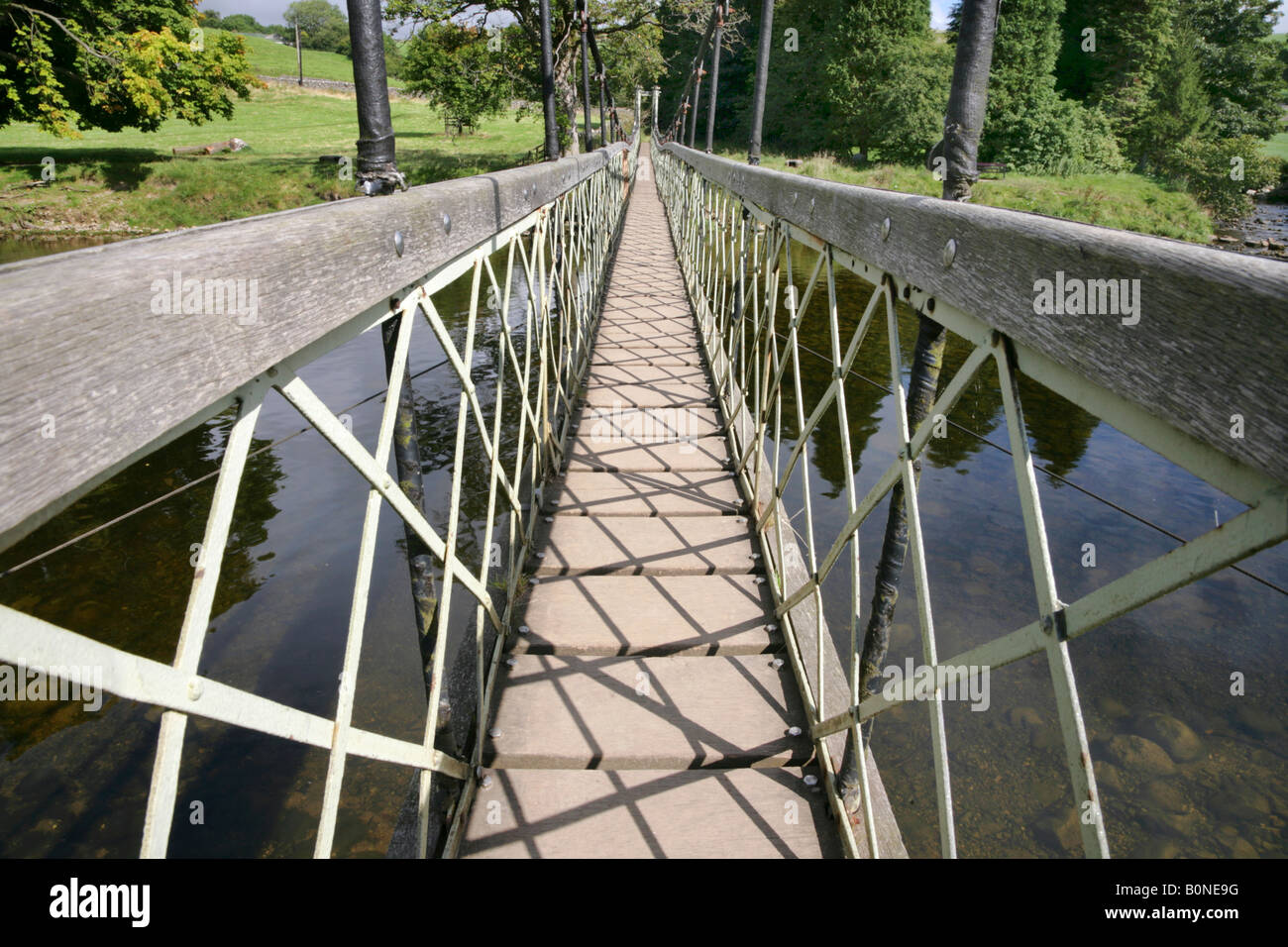 Suspension footbridge over the River Wharfe near Hebden, Yorkshire Dales. Stock Photo