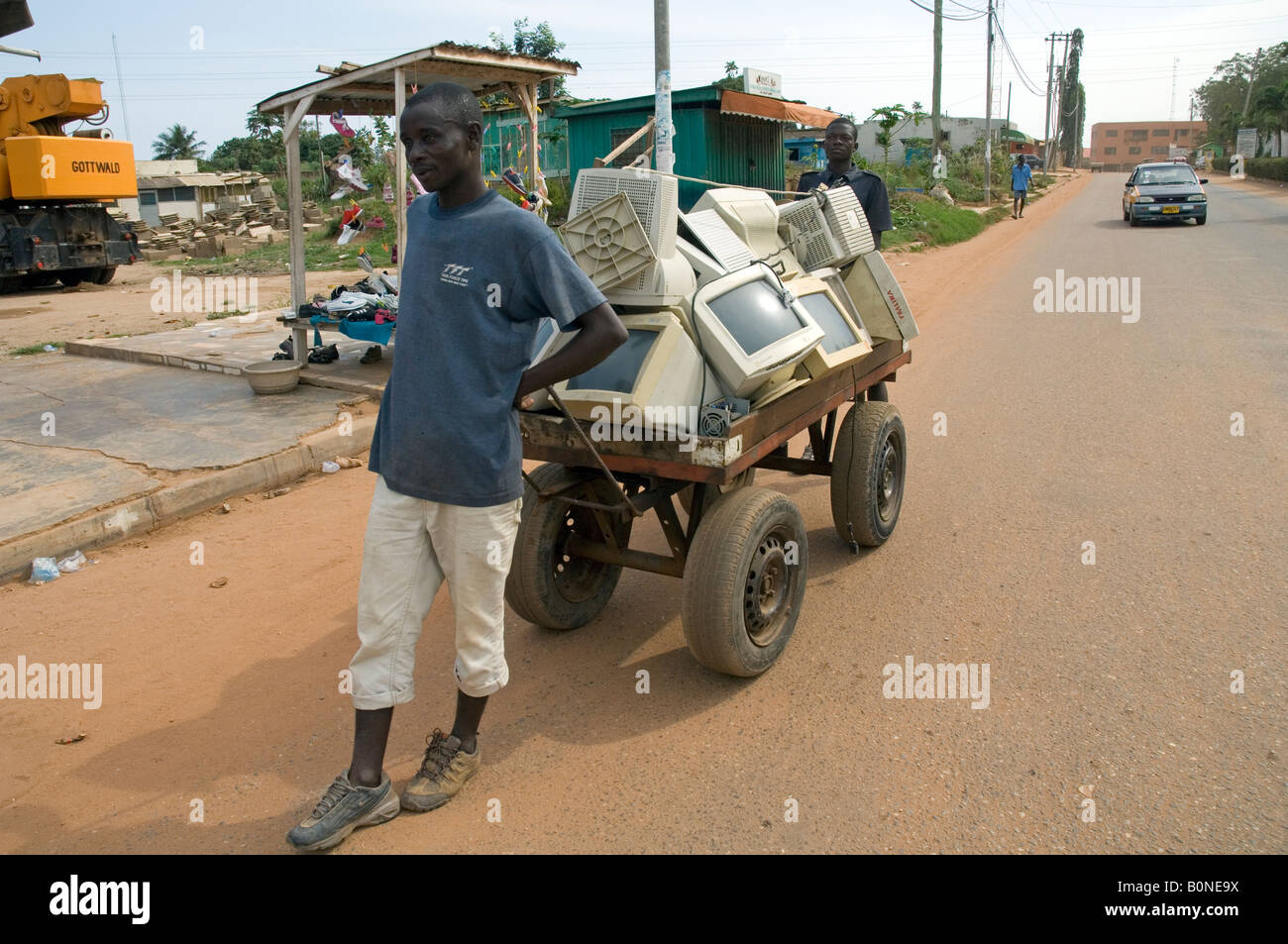 Scrap sellers pulling a cart with with computer trash, Nsawam Ghana - Stock Image