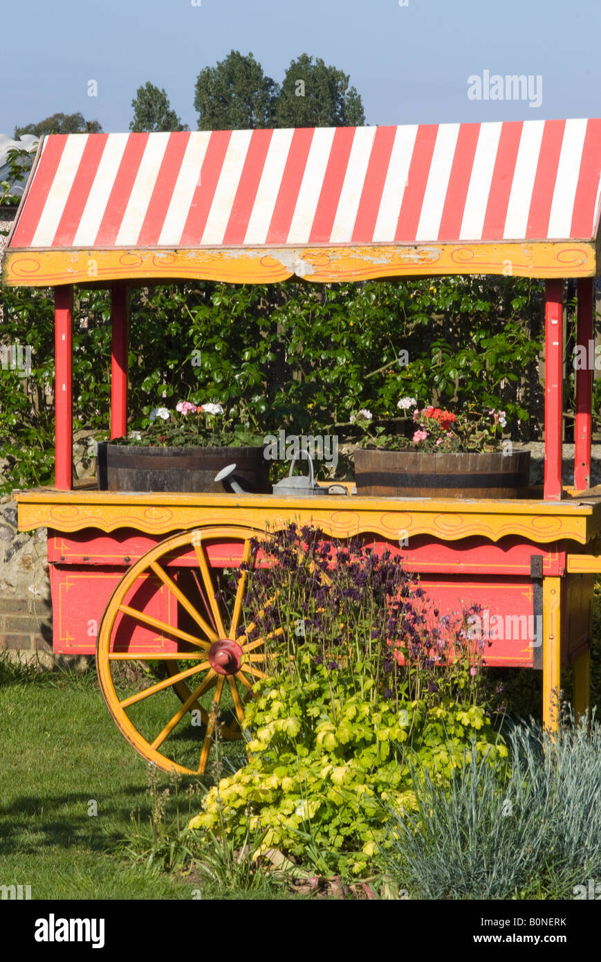 Covered Garden Cart With Red and White Striped Awning and ...