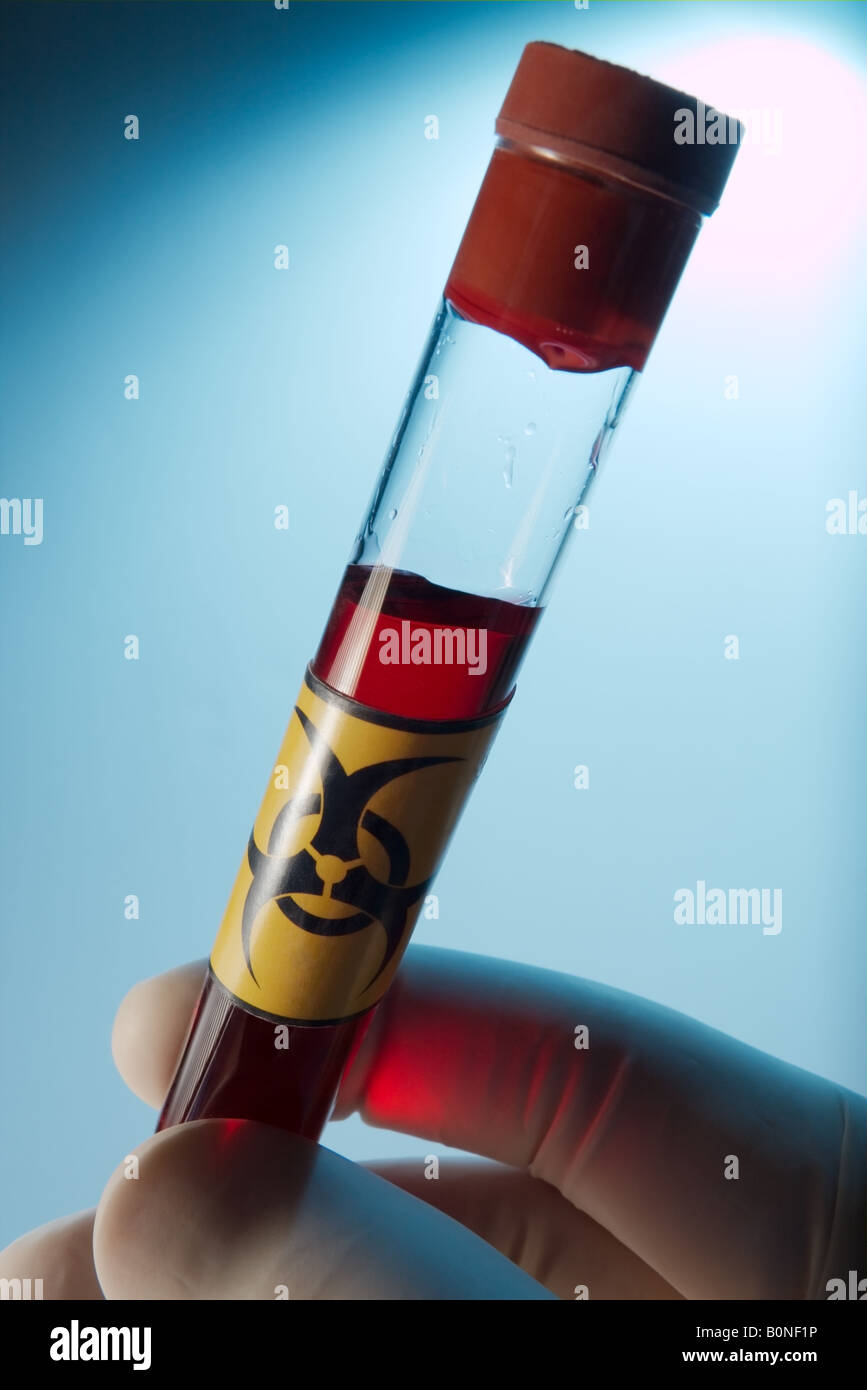 Test tube filled with red liquid - Stock Image