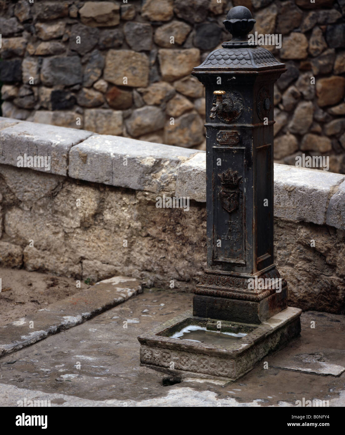Communal water tap Cefalu Sicily Italy EU - Stock Image