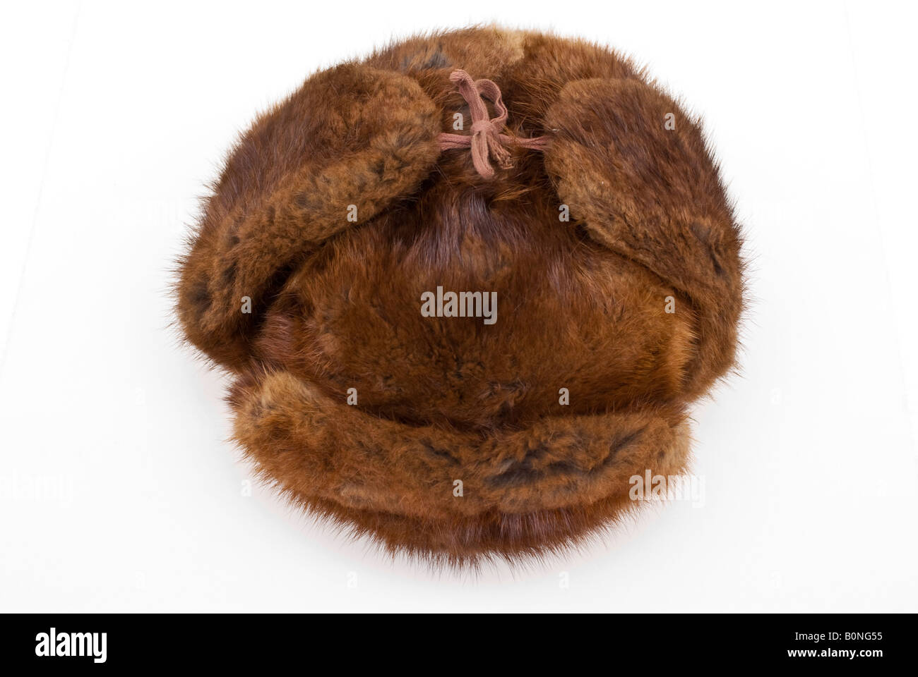 6db1857386073 A well worn genuine Russian fur hat or shapka with ear flaps tied above the  crown