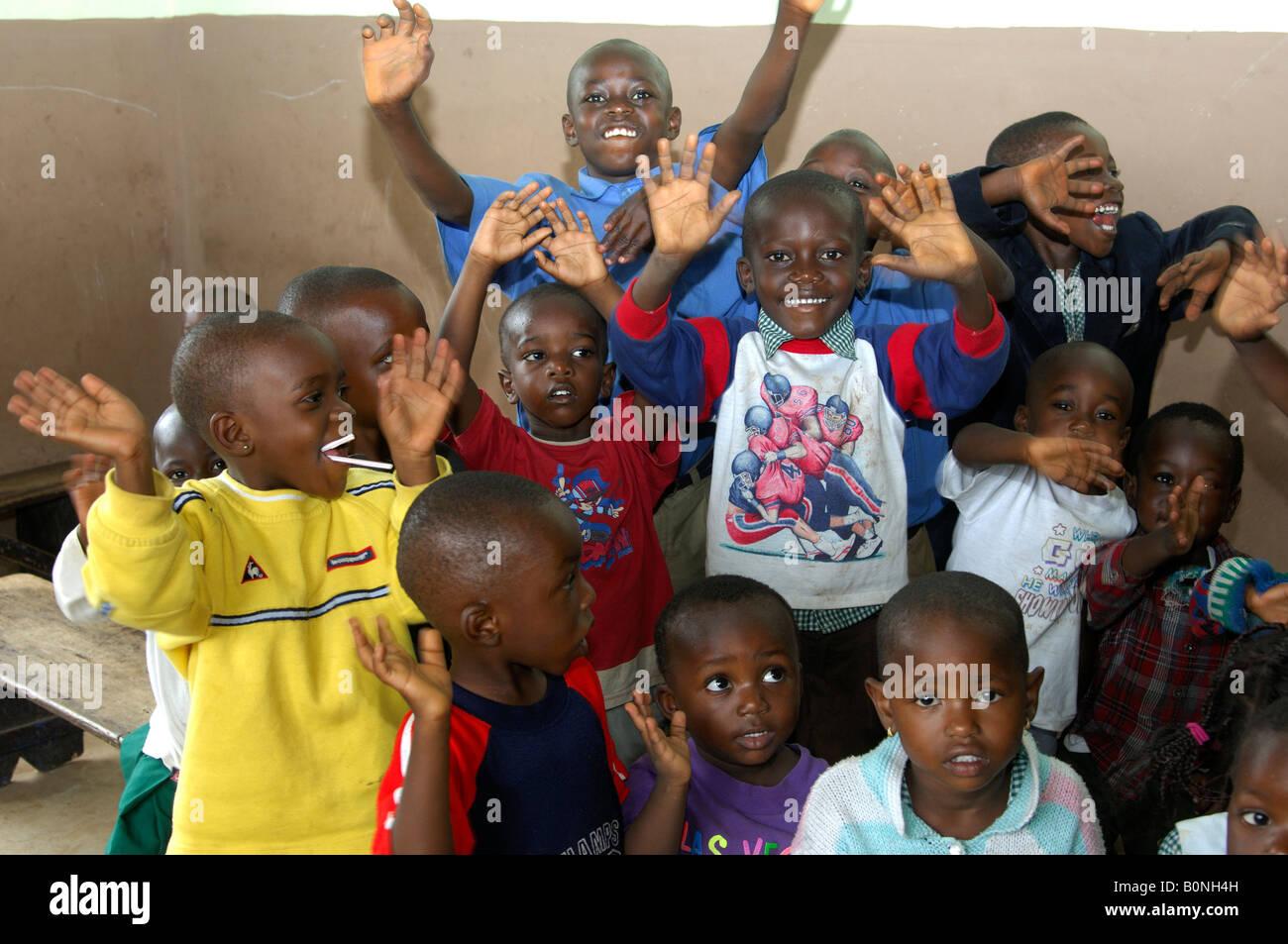 Rackety pre-school children in a day care centre in Akropong Akwapim, Eastern Region, Ghana - Stock Image