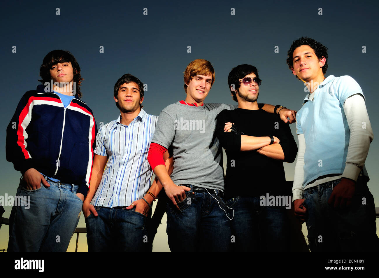 Portrait of young trendy teenager group of friends standing together - Stock Image