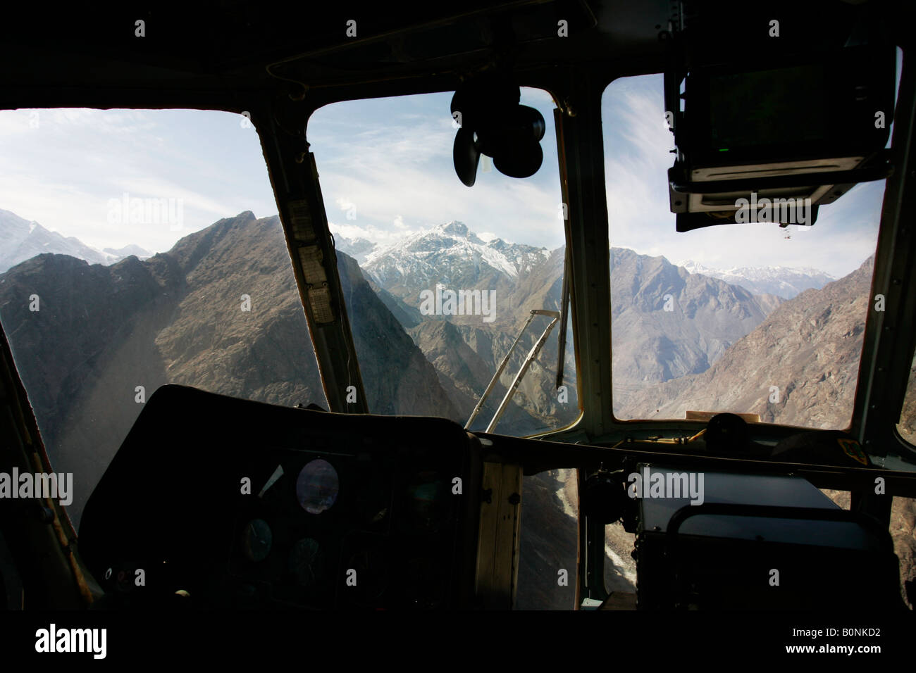 Peaks of Karokoram Mountains from helicopter cockpit Skardu Valley North Pakistan - Stock Image
