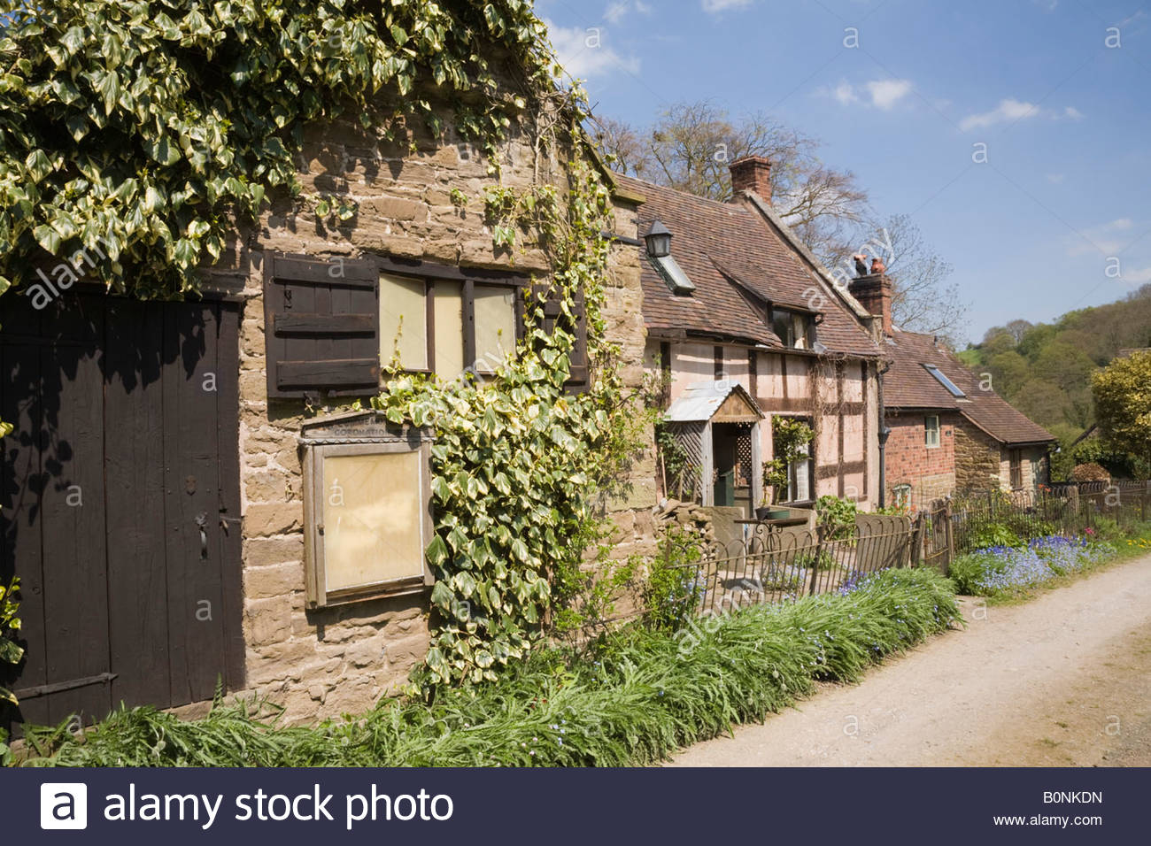 Quaint old English cottages and outbuilding on country lane in rural village of Hope Bowdler Shropshire West Midlands - Stock Image