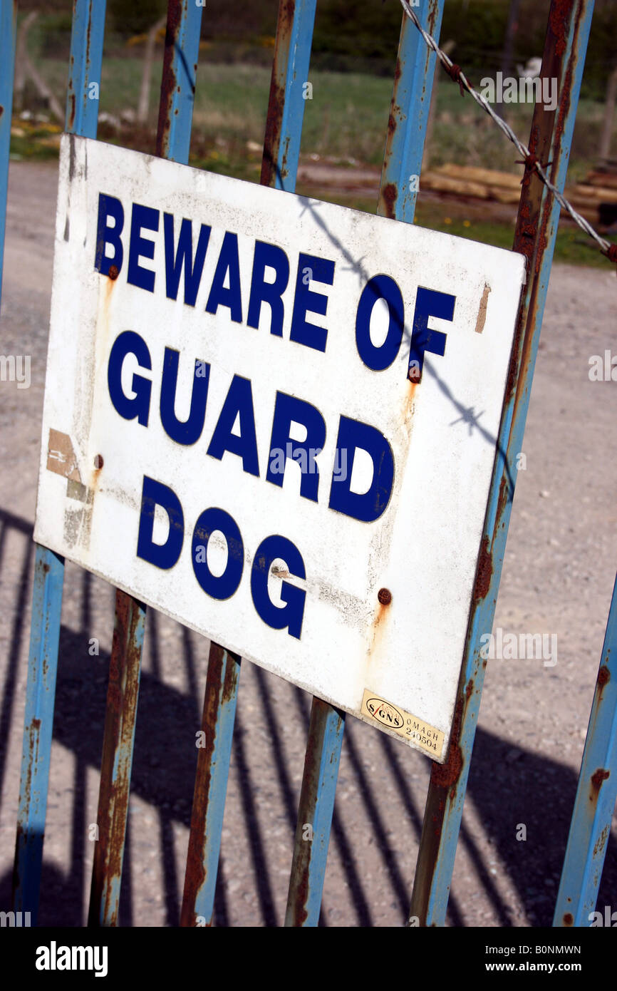 Beware of guard dog sign on steel gate to building site, Ireland - Stock Image