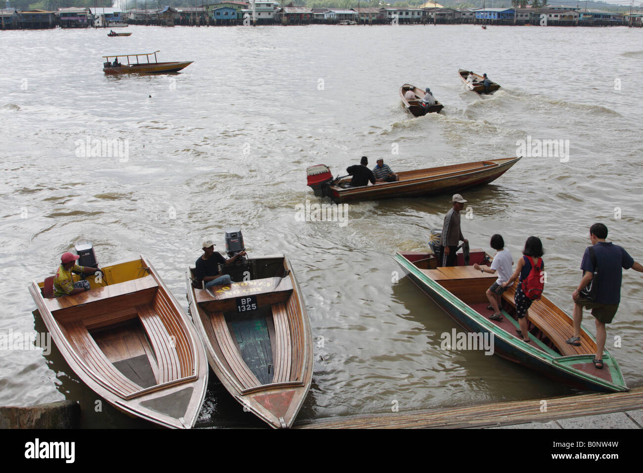 Water Taxis Heading To Kampung Ayer, Brunei - Stock Image