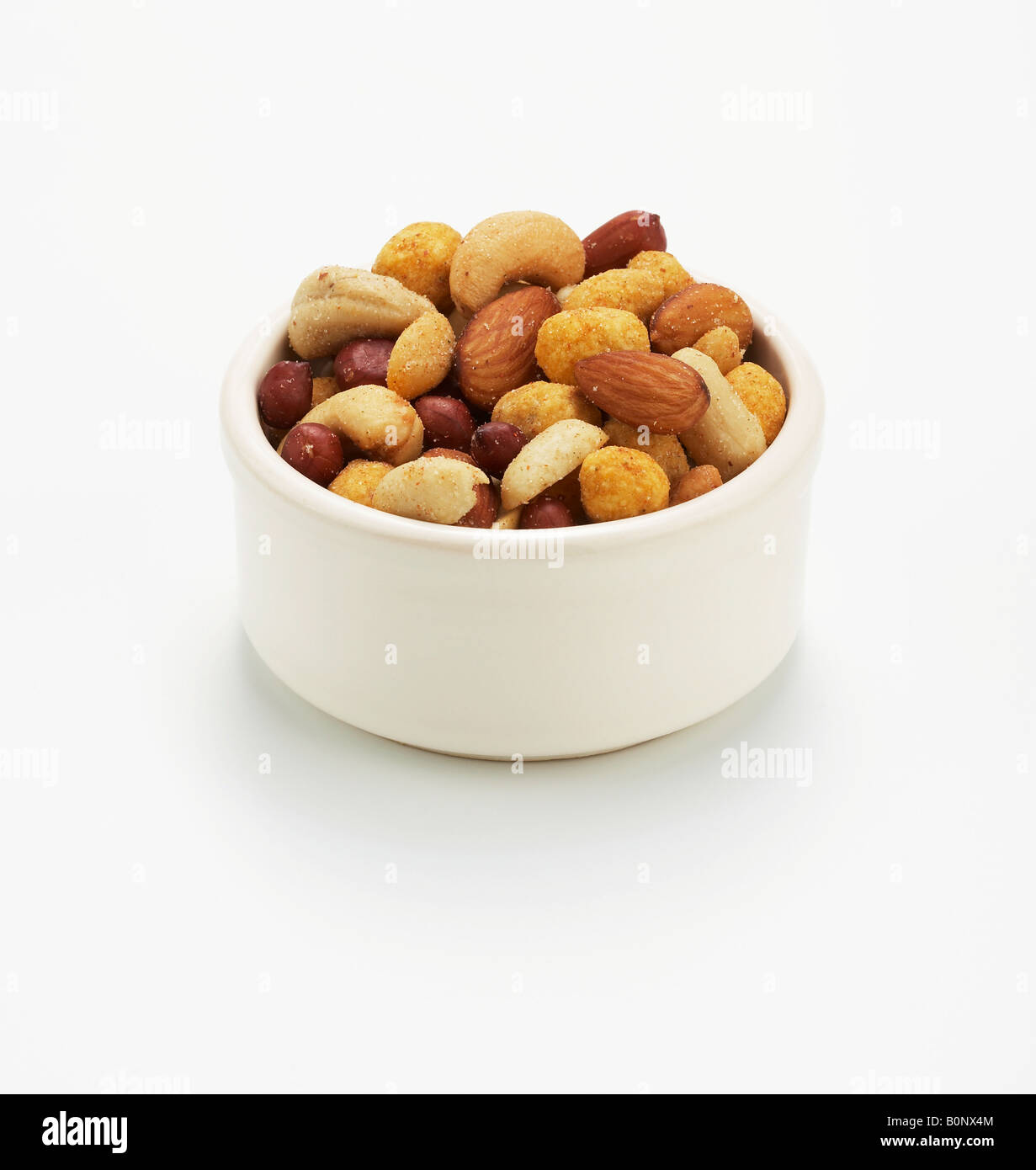 bowl of salted mixed nuts - Stock Image