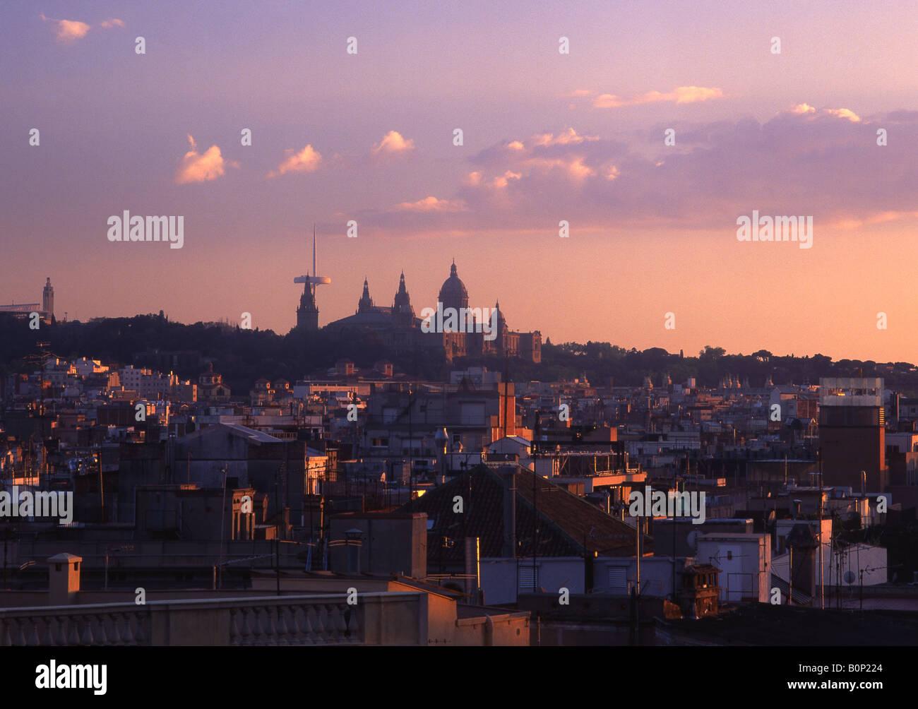 View over rooftops of Raval to Palau Nacional and Montjuic Barcelona Catalunya Spain - Stock Image