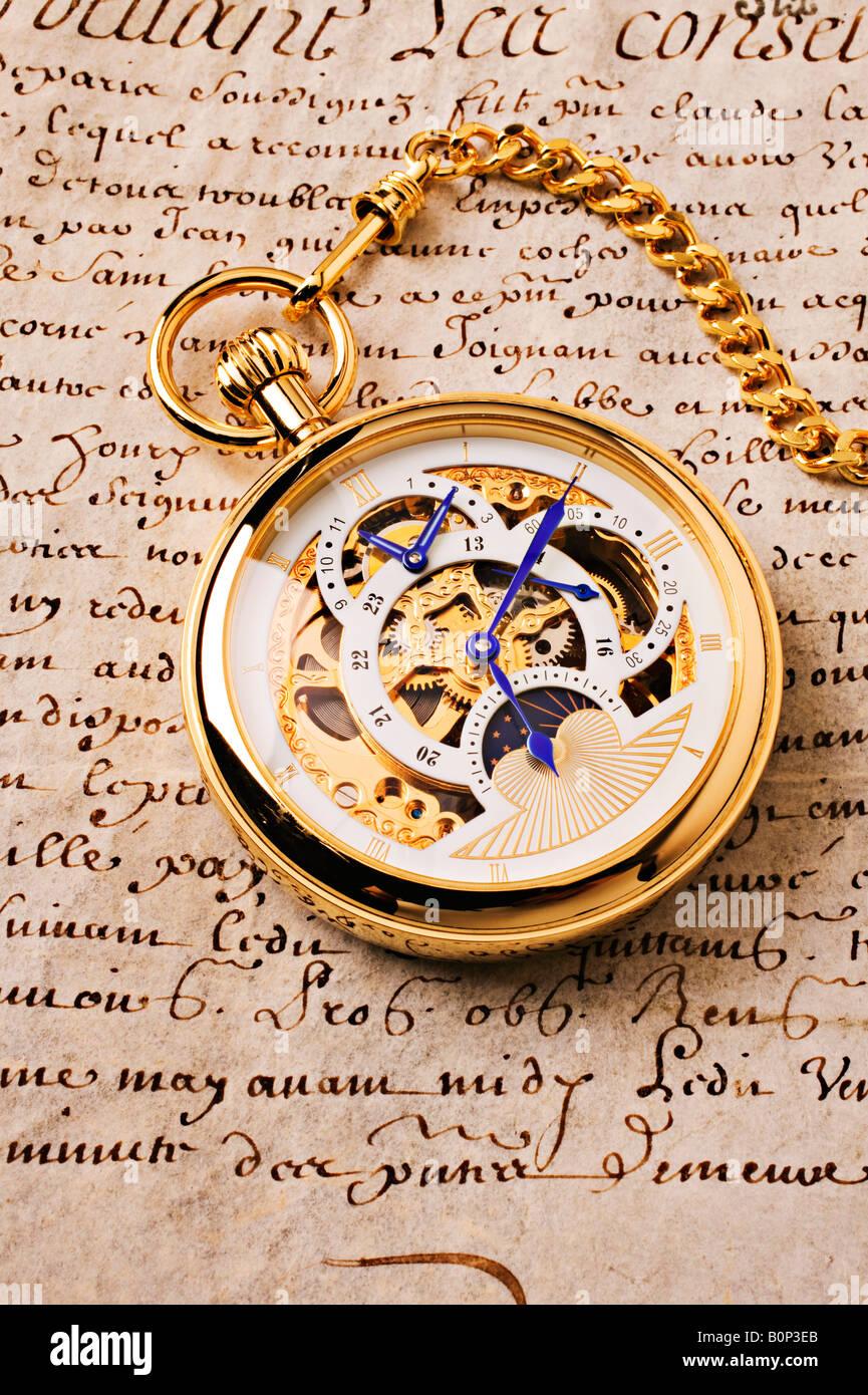 Gold pocket watch Stock Photo
