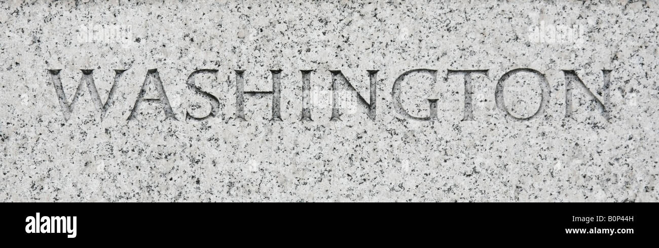 Washington state name written in grey granite stone - Stock Image