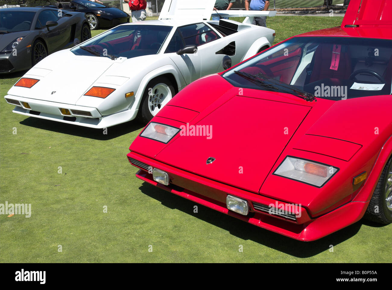 A Front Quarter View Of Two Lamborghini Countach S One Red One