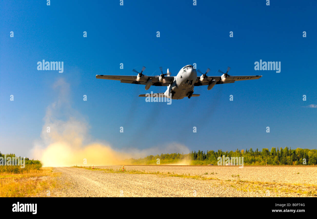 Alaska Air National Guard C 130 on takeoff from the Bettles gravel runway on a day in August 2007 - Stock Image
