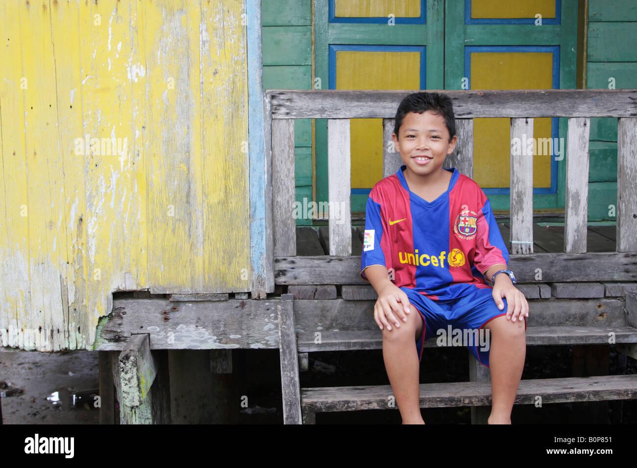 Boy Of Stilt Village Of Kampung Ayer,Brunei - Stock Image