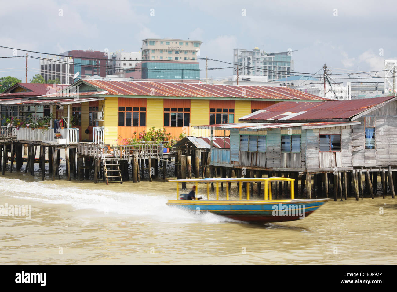 Boat Speeding Through Stilt Village Of Kampung Ayer, Brunei - Stock Image