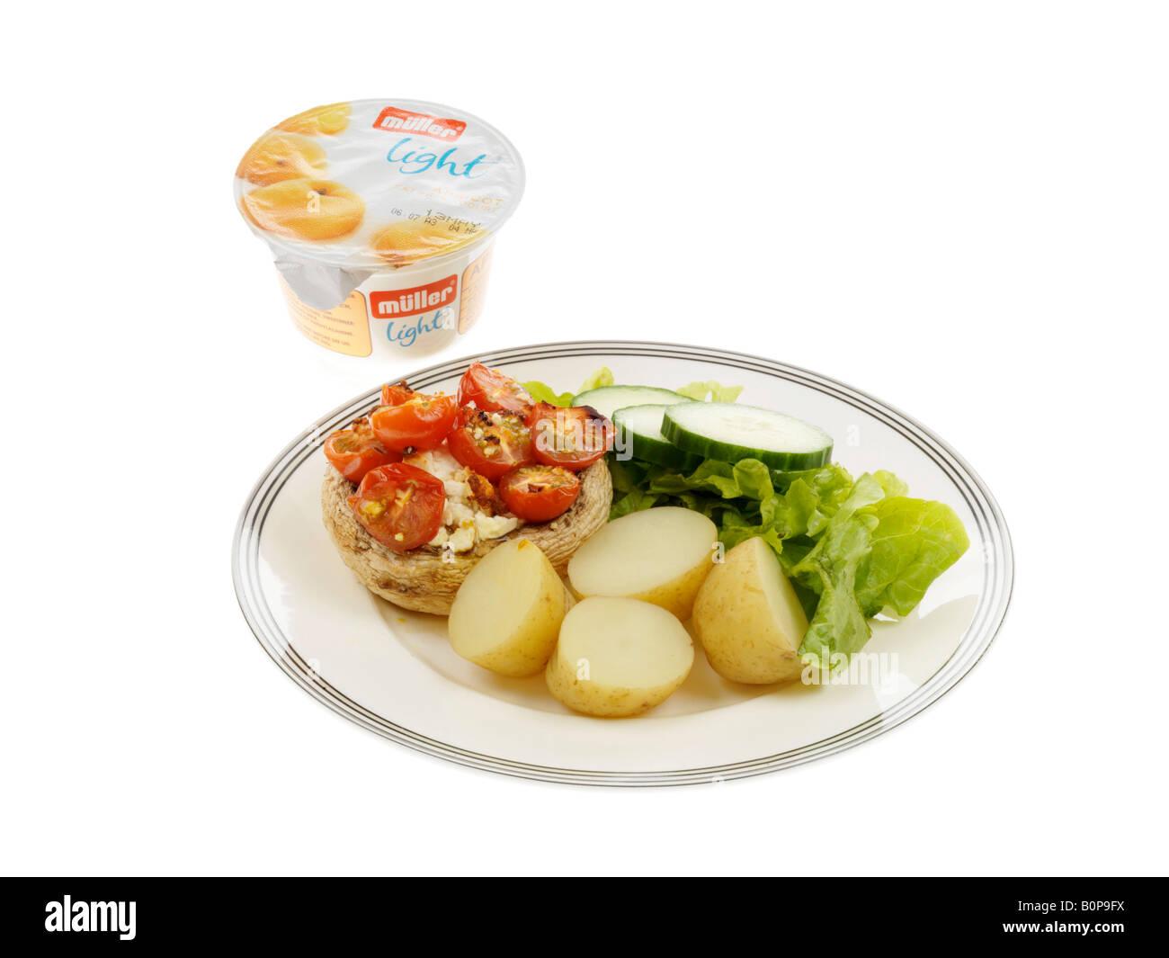 Stuffed Mushrrom with Salad and New Potatoes Stock Photo