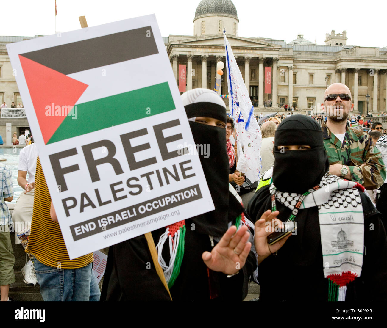 Young Palestinian Woman Holding Banner At The Freedom For Palestine Raleigh Trafalgar Square London UK Europe 2008 - Stock Image