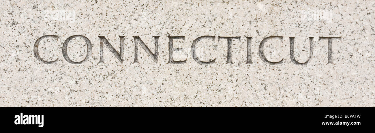 Connecticut state name written in grey granite stone - Stock Image